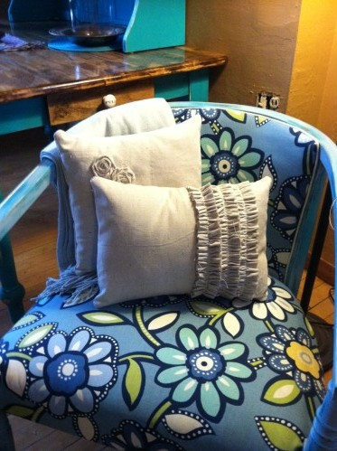 pillow on blue chair