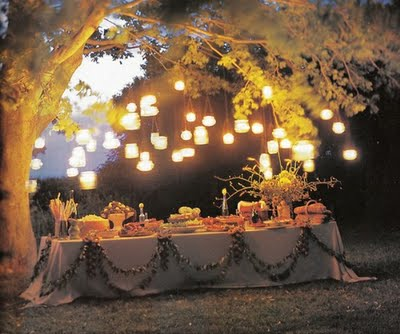 outdoor space - outdoor dining - flowers - romantic buffet table - lantern chandeliers  - outdoor decor and design - dining room pillow chairs via pinterest